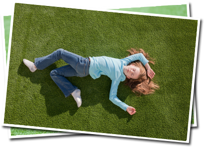 Image of a child laying on grass