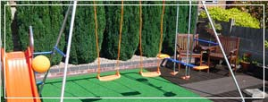 Image of a playground with artificial grass